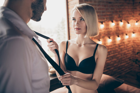 Portrait of two person nice-looking lovable sweet stunning gorgeous attractive feminine lady teasing businessman successful guy in loft brick industrial style interior room house hotel indoors