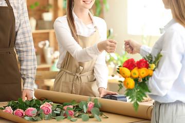 Woman buying bouquet in flower shop