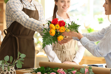 Woman buying bouquet in flower shop