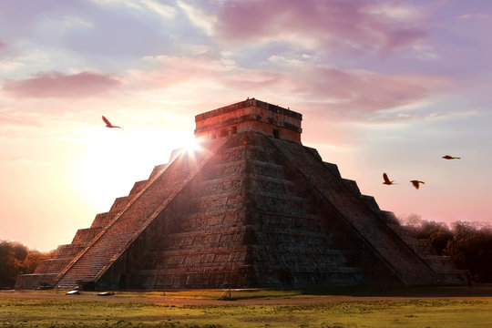 Archaeological complex Chichen Itza. Mayan pyramid on the background of a beautiful sunset. Temple of Kukulkan. Mexico. Yucatan.