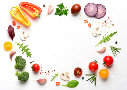 Vegan ingredients for homemade pizza on white wooden background. Top view with copy space.