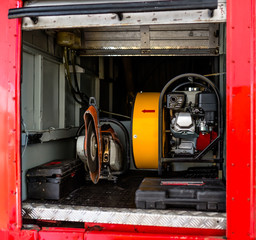 Mobile circular saw for cutting steel and concrete and portable smoke exhaust fan for diffusing smoke in the room, placed in a fire truck.