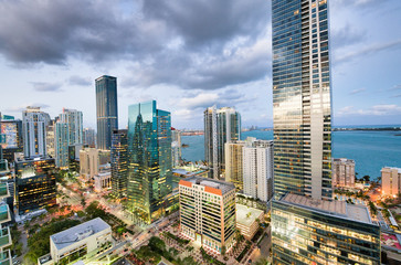 Fototapete - Amazing night skyline of Downtown MIami. Wide angle view of city skyscrapers on a cloudy morning