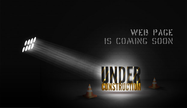 Web page poster Under construction with 3d text in spotlight on scene with cones on black background