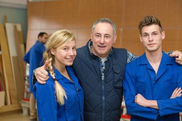 teacher hugging apprentices