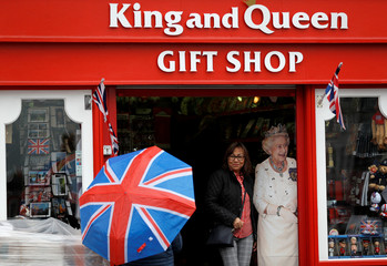 A woman gets a picture taken in a gift shop in Windsor