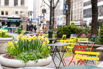 New York City, USA street view of urban NYC Herald Square Midtown with Greeley Square Park chairs tables and nobody by korea town koreatown
