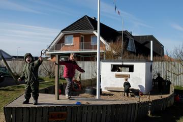 Children play at the Thyboron Bornecenter, a kindergarten and day care for local children, in the village of Thyboron in Jutland, Denmark