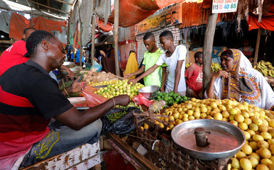 Residents buy fruits during the month of Ramadan at the Hamarweyne market in Mogadishu