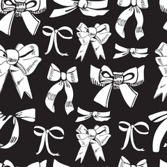 Seamless pattern with diferent white bows on black background. Hand drawn ink and inverted sketch.