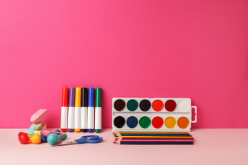 School supplies on ink vivid bright table, back to school concept, modern 3d background
