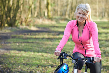 Portrait Of Mature Woman On Cycle Ride In Countryside