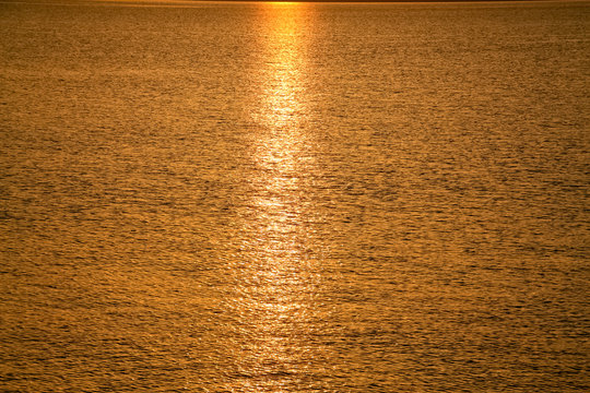 Sunrise on the surface of the waters of the Sea of Galilee