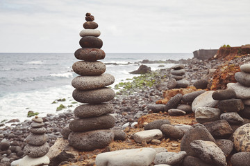Color toned picture of a stone stack on a beach.
