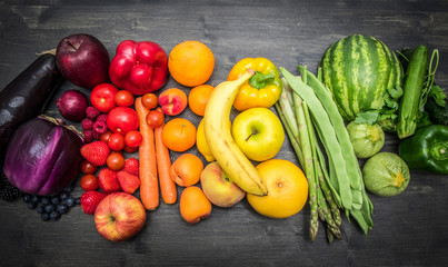 rainbow fruit and vegetables on wood