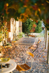 picnic table at tuscan villa with old chairs and table