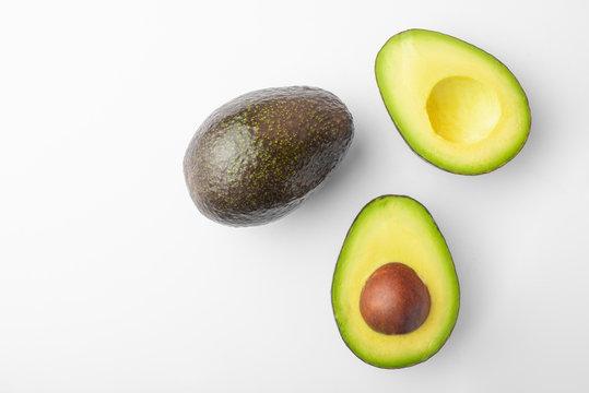 Ripe avocado sliced on white background, isolated