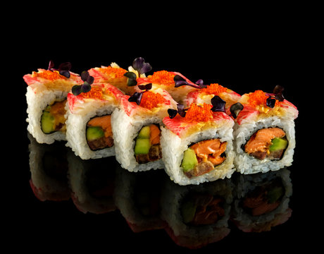 Set sushi roll. Traditional Japanese cuisine. Isolated on black background