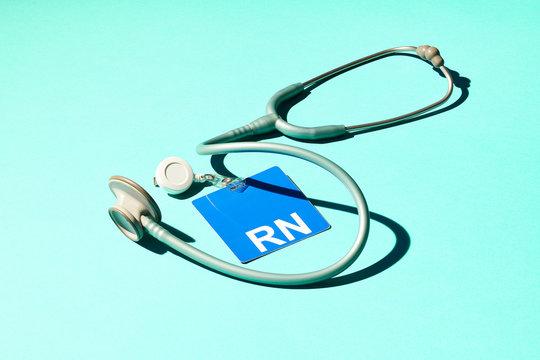 Registered Nurse ID Badge and Stethoscope on Blue Background