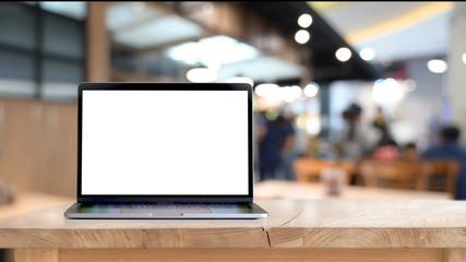 Fototapeta Mock up blank screen laptop on wood table obraz