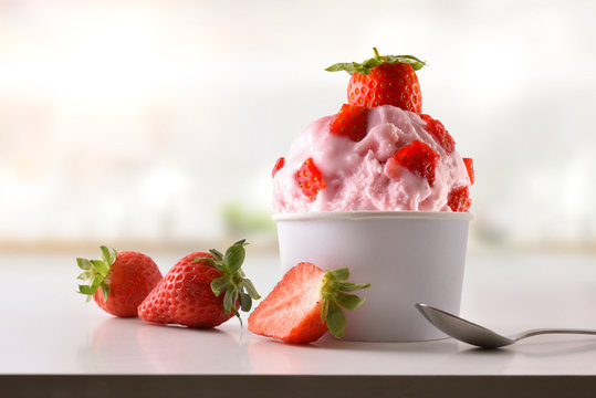 Strawberry ice cream cup on white table homemade in kitchen