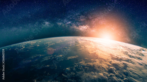 Wall mural Landscape with Milky way galaxy. Sunrise and Earth view from space with Milky way galaxy. (Elements of this image furnished by NASA)
