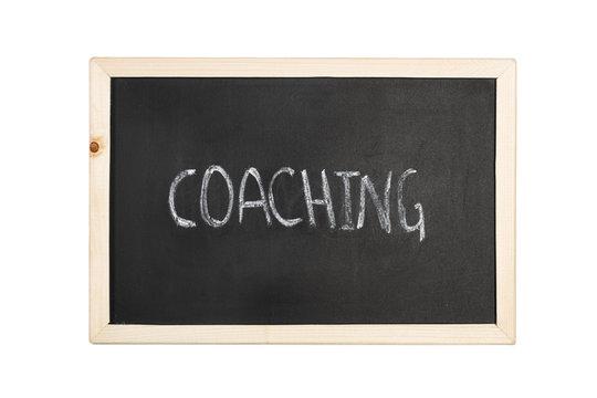 Pizarra con escritura coaching