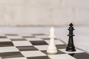 two chess pieces on the Board