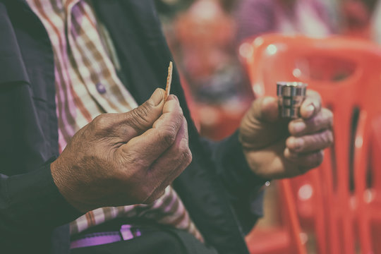 Faithful Asian Elder Praying in the Holy Communion and Praise Jesus.
