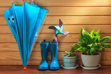 Umbrellas and rain boots on display
