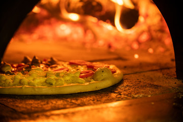 Italian pizza inside a wood oven