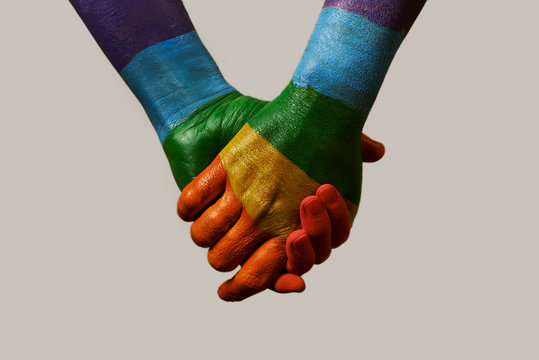 hands patterned with the rainbow flag