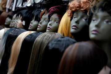Mannequins with wigs are seen in a stall at the Yiwu Wholesale Market in Yiwu