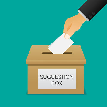 Hand putting paper in the suggestion box.