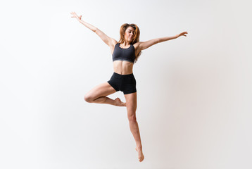 Young dance girl over isolated white wall.