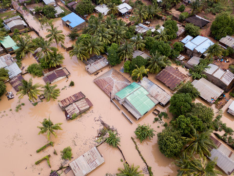 Aerial view overhead houses flooded by a cyclone
