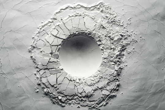 Texture background of an impact crater. Background usable for still life photography.