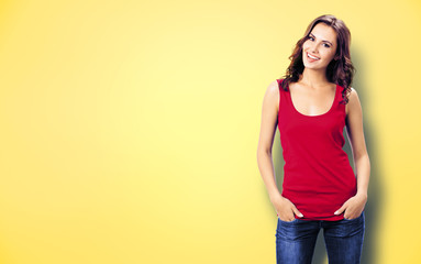 Photo of happy smiling woman, over yellow