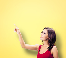 Photo of woman showing something or copy space