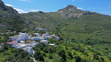 Printed kitchen splashbacks Khaki Aerial drone photo of picturesque traditional village of Koumaros in the slopes of mountain and castle of Exomvourgo or Exombourgo with beautiful deep blue sky, Tinos island, Cyclades, Greece