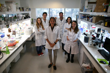 Marina Simian, a medical researcher, poses for a picture with members of her team, in Buenos Aires