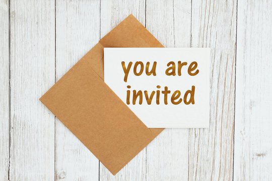 You are invited text on a greeting card with envelope