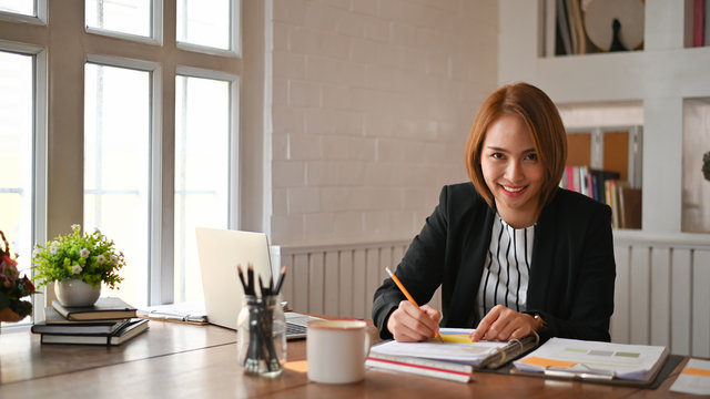 Businesswomen working on office workplace.
