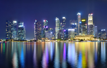 Fotomurales - Panorama view of Singapore city skyline at night . Travel asia concept .