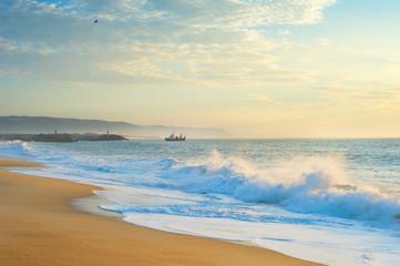 ocean beach fishing ship Portugal