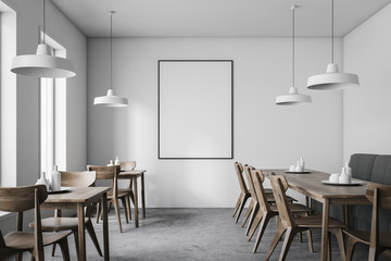White restaurant interior with poster
