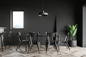 Black dining room and kitchen interior