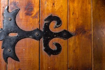 black metal handmade hinge on wooden chest