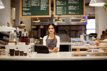 Portrait of owner standing in cafe