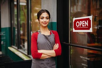 Portrait of owner standing at doorway
